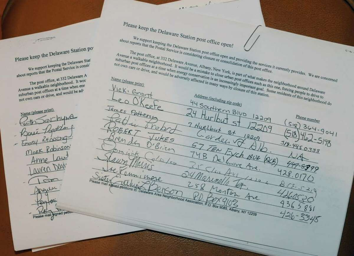 Signed petitions to keep the Delaware Station post office open at a meeting in the Elks Lodge on South Allen Street in Albany, NY on November 4, 2009. The petitions were gathered by the Delaware Area Neighborhood Association. (Lori Van Buren / Times Union)