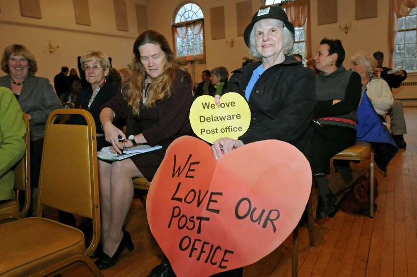 Eleanor Laing (cq), of Albany, holds signs to keep the Delaware Station post office open during a meeting in the Elks Lodge on South Allen Street in Albany, NY on November 4, 2009. Laing and Louise McNeilly next to her, are part of the Delaware Area Neighborhood Association. (Lori Van Buren / Times Union)