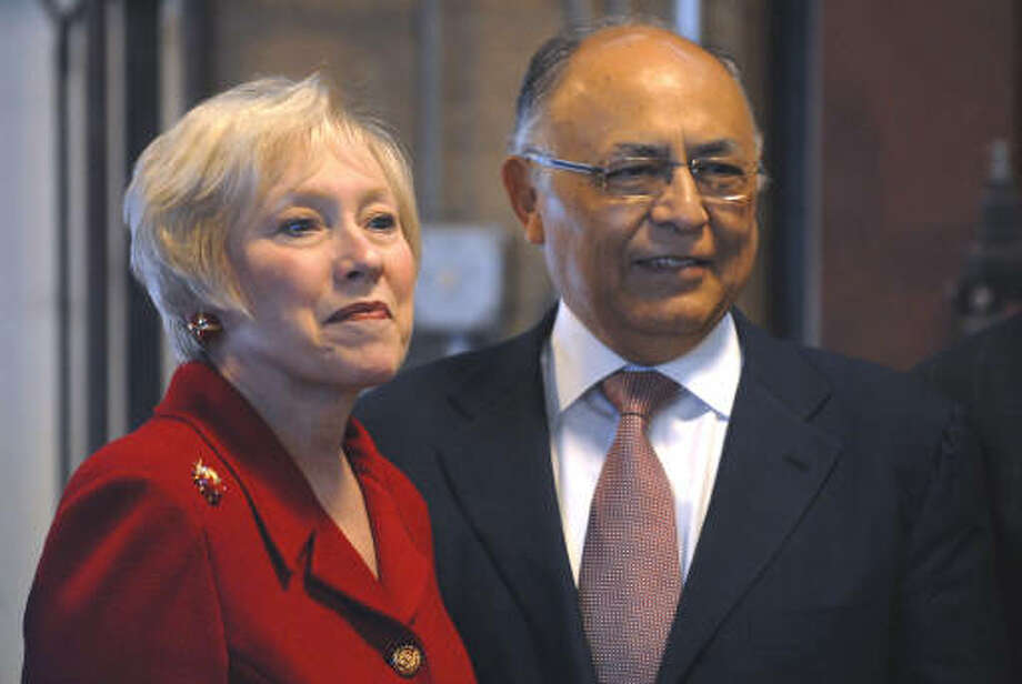 Hector Ruiz, Chairman of the Board of GlobalFoundries, right, and Nancy Zimpher, SUNY Chancellor, left, before President Barack Obama's speech at Hudson Valley Community College in Troy.  (Philip Kamrass / Times Union)
