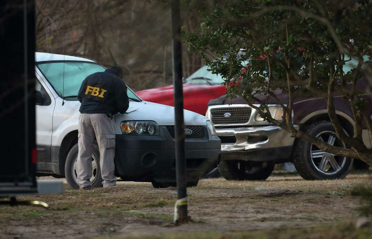 FBI agents investigate a scene on the 7300 block of Elbert Street Thursday, Jan. 25, 2018, in Houston.