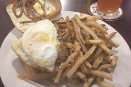The egg and chorizo sandwich with a side of French fries off of the menu at the Schlafly Tap Room.