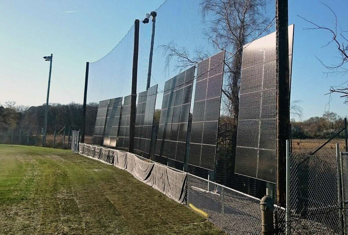 Solar panelsin the outfield at the Tom Haydon softball field on Old Dam Road are among the 32 solar energy projects the town has constructed. Fairfield,CT. 1/26/18