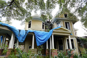 A blue tarp hangs on the roof on the Caroline Gilbert Hinchee House on Friday afternoon. Ed Touchet, who lives in Austin but grew up on Avenue A, is trying to buy the house to save it from demolition. The house was built in 1906. Photo taken Friday 1/19/18 Ryan Pelham/The Enterprise