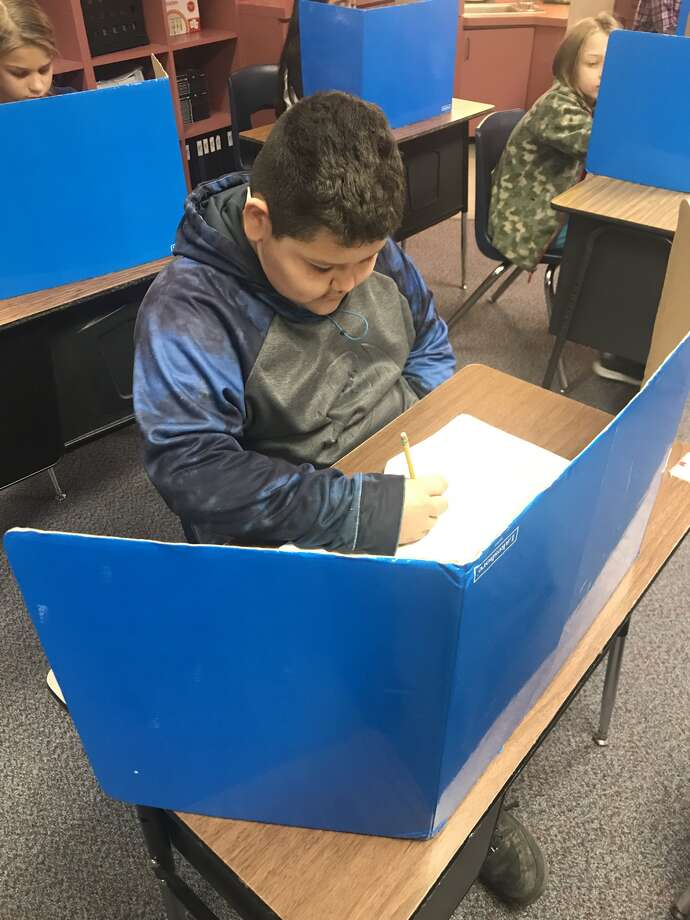 Alex Carmona, a fourth-grade student in Amanda Aycock's classroom at La Mesa Elementary and is busy taking the math benchmark test Monday. The benchmark tests are an important tool for the Plainview Independent School District to ascertain student development. Photo: Courtesy Photo