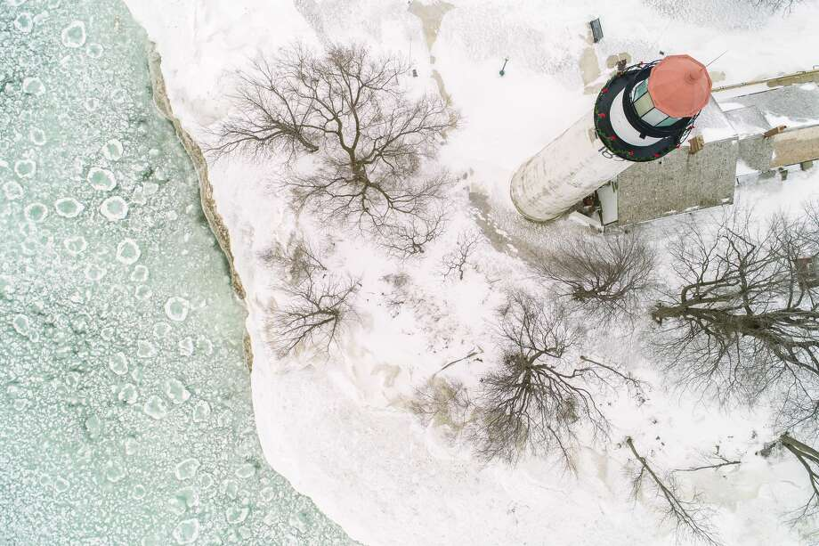 This drone image captures the aftermath of a recent light snowfall near the Pointe aux Barques Lighthouse. Photo: Tyler Leipprandt, Michigan Sky Media/For The Tribune