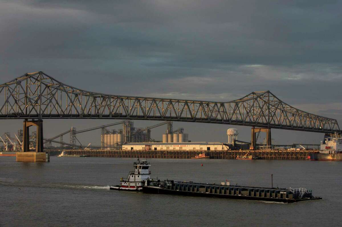 The sun rises over the Mississippi River in downtown Baton Rouge.