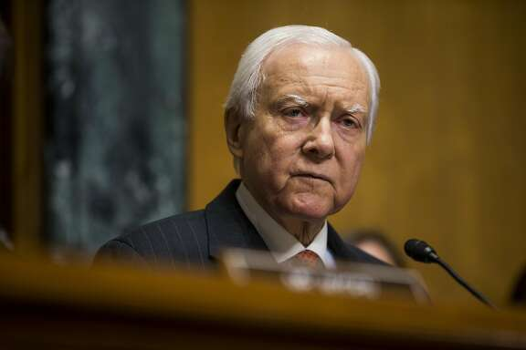 Senator Orrin Hatch, a Republican from Utah and chairman of the Senate Finance Committee, speaks during a confirmation hearing for Alex Azar, secretary of Health and Human Services (HHS) nominee for U.S. President Donald Trump, not pictured, in Washington, D.C., U.S., on Tuesday, Jan. 9, 2018. Until about a year ago, Azar was an executive at drugmaker Eli Lilly, a role thats fueled lawmakers' concerns that he might not be willing to take a tough stance against the pharmaceutical industry on drug prices. Photographer: Zach Gibson/Bloomberg