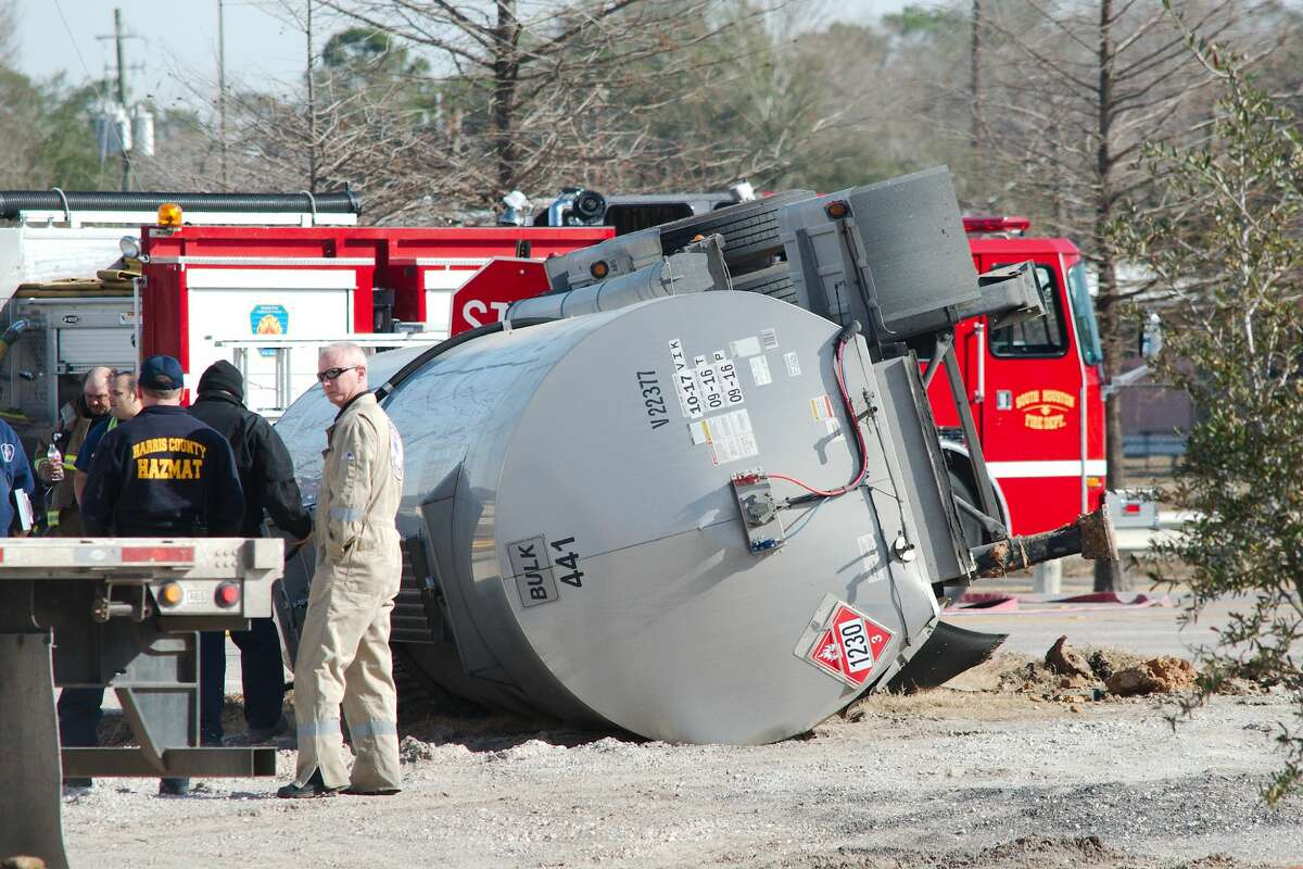 Harris County Hazmat officials, police officers and cleanup workers report to the scene of an overturned tanker truck on Winkler near Highway 3 in South Houston Thursday, Jan 25.