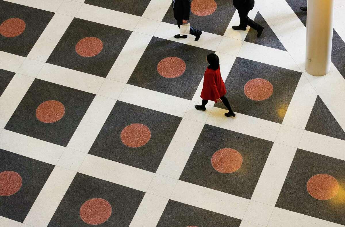 University of Houston president Renu Khator walks through the Hines College of Architecture, Wednesday, Jan. 24, 2018, in Houston.