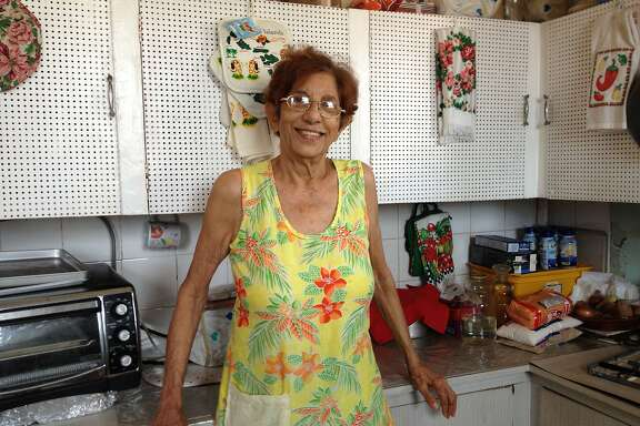 Auntie Doll (Victoria Ramessar) the last time she cooked for her family, in her kitchen in San Fernando, Trinidad.� The pegboard reminds me of Julia Child's kitchen.