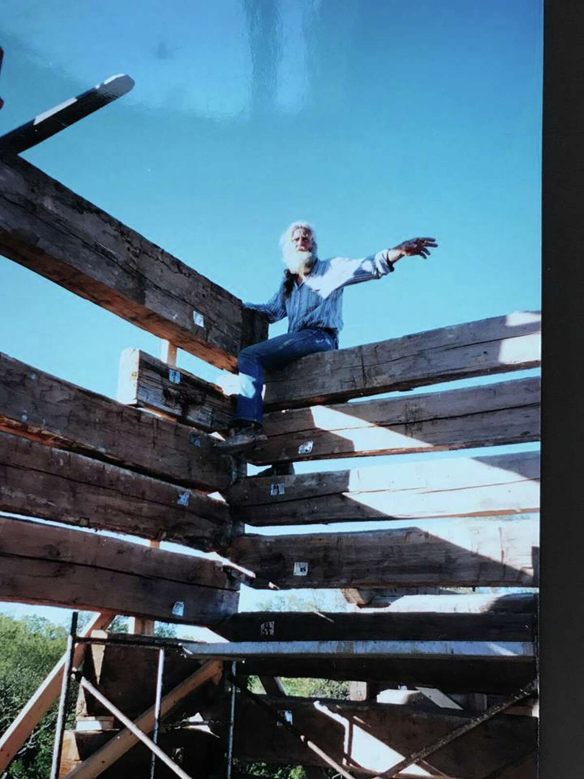 Three 150-year-old cabins were deconstructed, transported to Texas and erected on Gloria Frame's Lake Travis property.