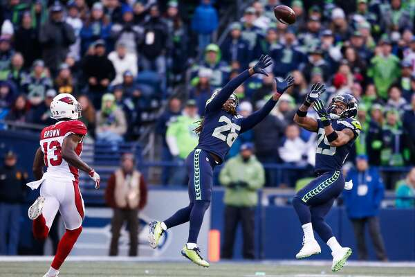 SEATTLE, WA - DECEMBER 31:  Cornerback Shaquill Griffin #26 of the Seattle Seahawks and Earl Thomas #29 prepare to intercept the ball from Quarterback Drew Stanton #5 of the Arizona Cardinals, but Griffin comes up with the ball in the third quarter at CenturyLink Field on December 31, 2017 in Seattle, Washington. (Photo by Otto Greule Jr /Getty Images)