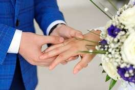 The hands of the bride and groom. Wear rings.