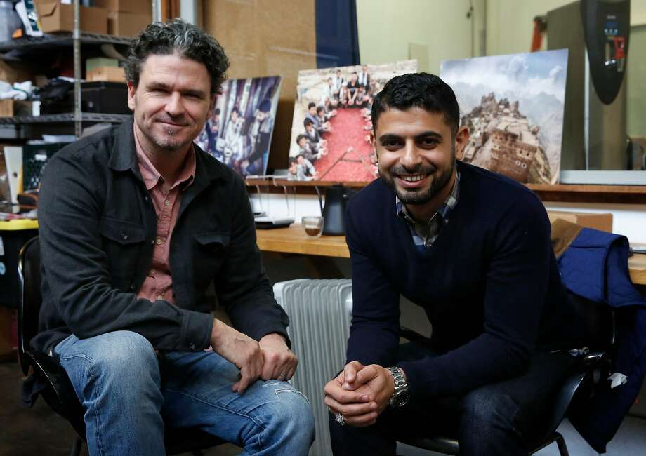 David Eggers with Mokhtar Alkhanshali at Port of Mokha, Alkhanshali's coffee-roasting company in Oakland. Photo: Michael Macor, The Chronicle