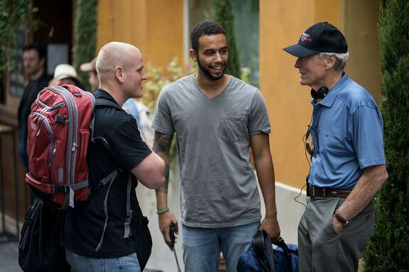 "Spencer Stone, left, and Anthony Sadler star in ""15:17 to Paris,"" which is based on their realf-life heroism and directed by Clint Eastwood, at right."