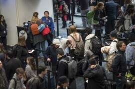 Travelers go through a security line at San Francisco International Airport (SFO) in San Francisco on Dec. 23, 2017.