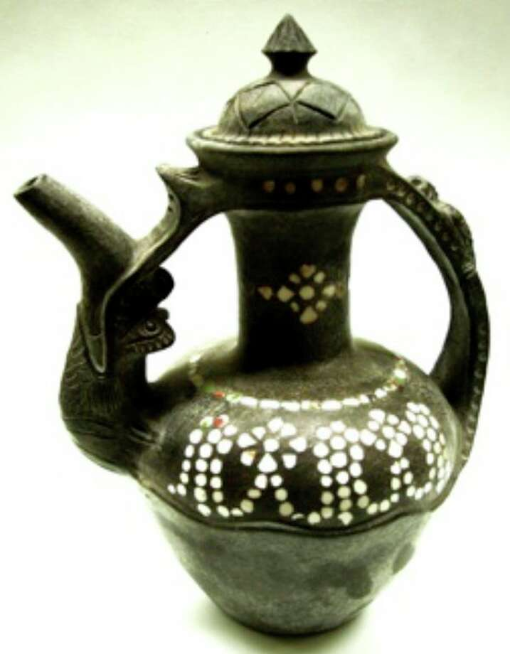 Yunnan-Tibetan Yak teapot, part of 'Chinese Folk Pottery, The Art of the Everyday,' exhibit at Marshall M. Fredericks Sculpture Museum, located on the campus of Saginaw Valley State University