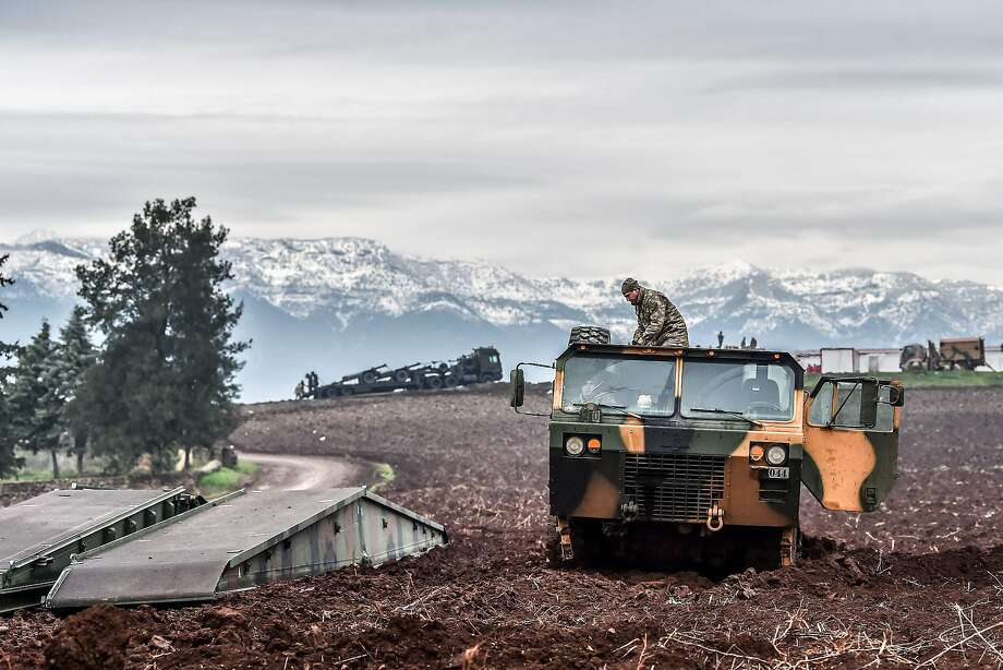Turkish troops wait near the Syrian border as part of an operation to oust the People's Protection Units militia, which Turkey considers to be a terror group, from its enclave of Afrin. Photo: OZAN KOSE, AFP/Getty Images