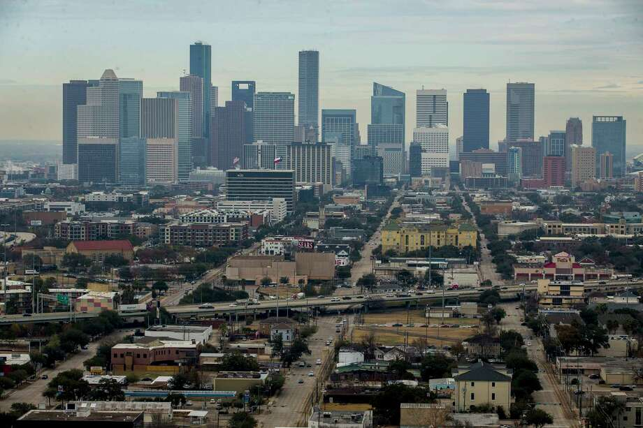 "Midtown is seen from the south looking downtown from the Warwick Tower, Friday, Jan. 19, 2018, in Houston. The area, centered around the Sears building, is being proposed for redevelopment as part of an ""innovation corridor"" stretching from downtown through the medical center. Photographed from the Warwick Tower high-rise on Hermann Drive. Photo: Mark Mulligan, Houston Chronicle / © 2018 Houston Chronicle"