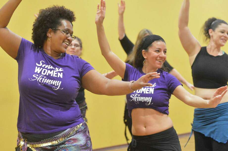 Above, Aleathea Robinson gets some direction from instructor Tava Naiyin during a belly dancing class at Dance Dimension to raise money for the Best Friends Animal Society and local food pantries in Norwalk on Sunday. Participants brought in nonperishable food items and made monetary donations. Pamela Ortiz, right, of Derby, works on hand movements during a belly dancing class. Photo: Alex Von Kleydorff / Hearst Connecticut Media / Norwalk Hour