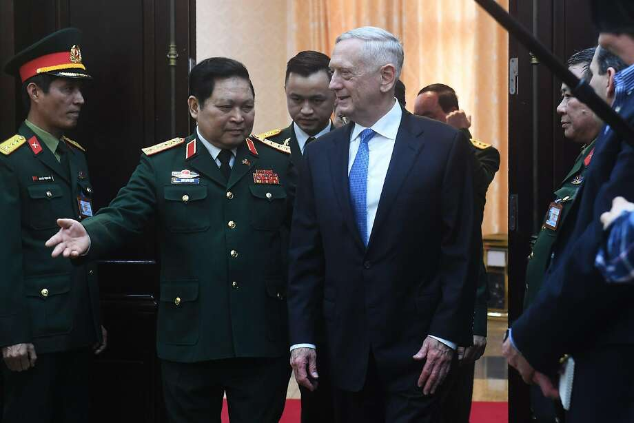 Secretary of Defense James Mattis (right) and Defense Minister Ngo Xuan Lich, arrive for official talks in Hanoi. Mattis is on a two-day visit to Vietnam. Photo: HOANG DINH NAM, AFP/Getty Images
