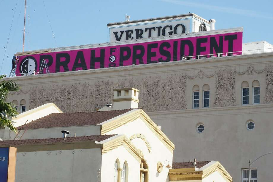 "An ""Oprah For President"" signs hangs atop a downtown building in Los Angeles. Some Democrats want their own celebrity candidate in 2020. Photo: ROBYN BECK, AFP/Getty Images"