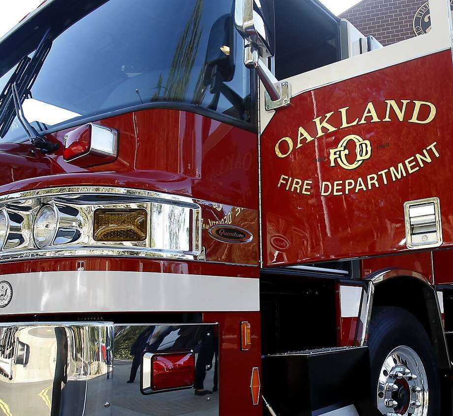 Oakland Fire Department engine sit in outside fire station in Oakland. Photo: Bill Hutchinson/ The Chronicle