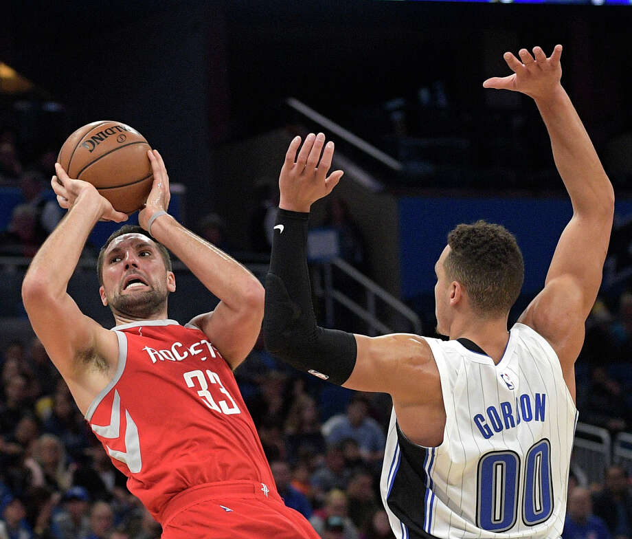 Houston Rockets forward Ryan Anderson (33) is fouled by Orlando Magic forward Aaron Gordon (00) while taking a shot during the first half of an NBA basketball game Wednesday, Jan. 3, 2018, in Orlando, Fla. (AP Photo/Phelan M. Ebenhack) Photo: Phelan M. Ebenhack/Associated Press