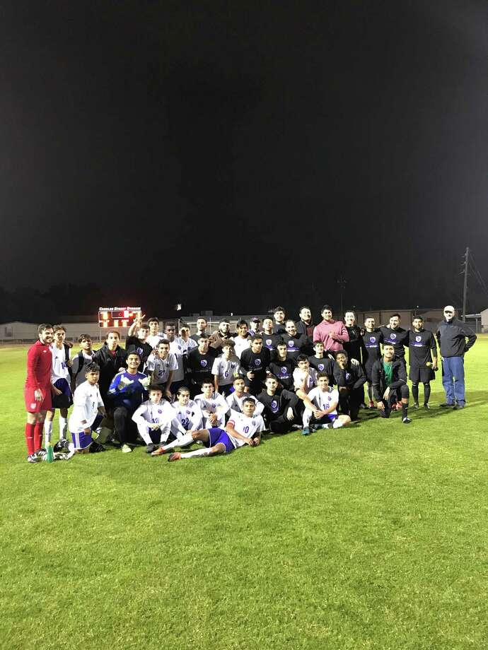 The current Humble High school soccer players and Humble soccer alumni pose together for a picture after the Humble soccer Alumni game on Saturday, January 20 at Charles Street Stadium Photo: Saul Keene
