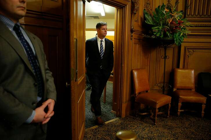 Supervisor Mark Farrell walks back into the meeting at City Hall after being voted interim mayor by the board of supervisors, Tuesday, Jan. 23, 2018, in San Francisco, Calif.