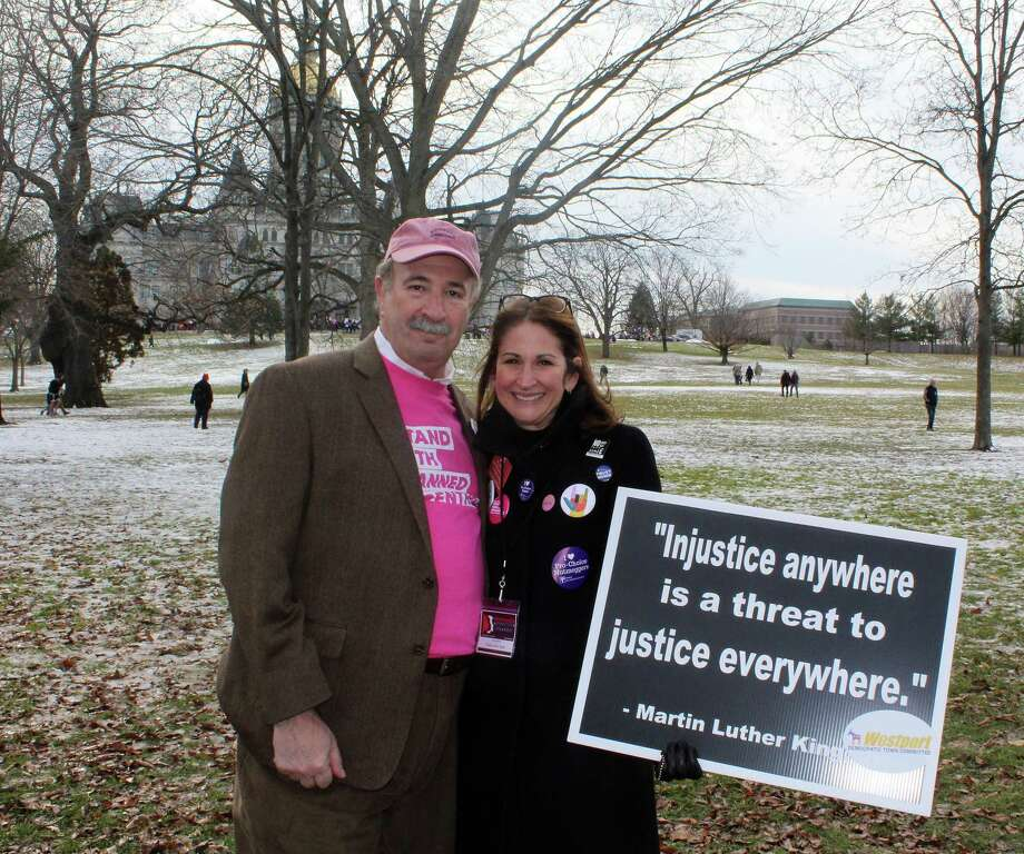 """""""I'm feeling great. It's a good day to protest, especially with the way women have been treated. This is a good time to talk about women's issues."""" —Selectman Melissa Kane, right, with State Rep. Jonathan Steinberg Photo: Sophie Vaughan /Hearst Connecticut Media /"""