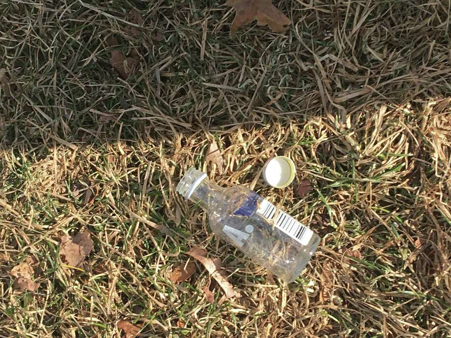 A nip bottle as scene on the grass near the Fairfield traffic circle by I-95. Photo: Thomas Lawlor / Hearst Connecticut Media