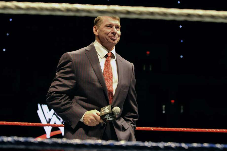 """FILE - In this Oct. 30, 2010 file photo, WWE chairman and CEO Vince McMahon speaks to an audience during a WWE fan appreciation event in Hartford, Conn.   WWE's 'Raw' set out to be a special kind of wrestling show from its birth on Jan. 11, 1993. """"Welcome everyone, to Monday Night Raw!"""" McMahon bellowed. """"We are live from New York City!"""" The WWE will celebrate the 25th anniversary of """"Raw"""" on Jan. 22, 2018 at its original home of the Manhattan Center with some of the biggest stars in the company's history stopping by for a fight. (AP Photo/Jessica Hill, File) Photo: Jessica Hill / Associated Press / AP2010"""