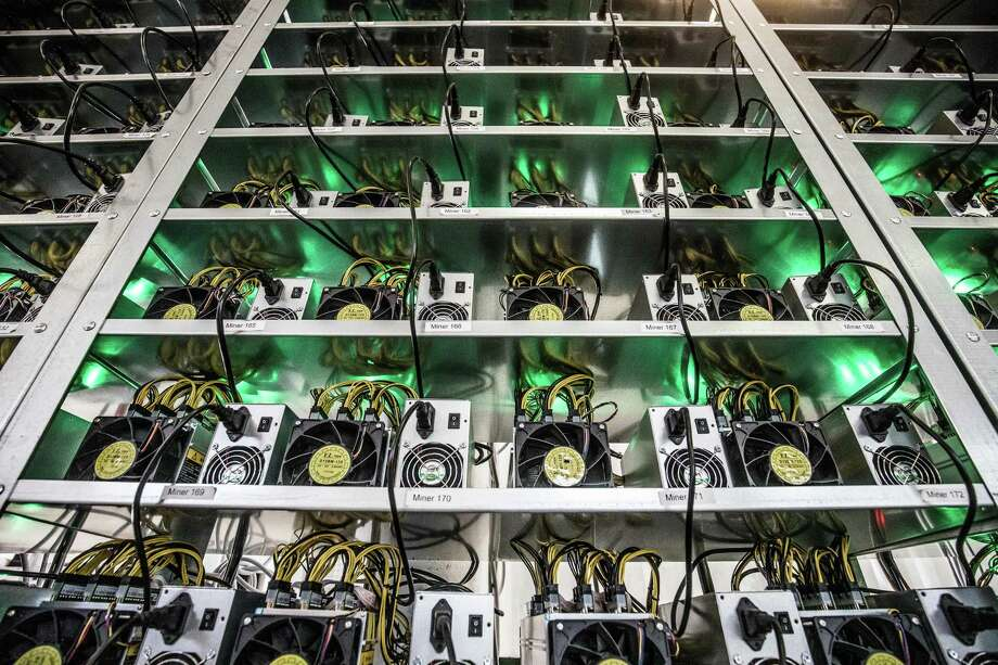 "Cryptocurrency mining rigs are shown here. Texas securities regulators have issued an emergency cease-and-desist order against Hong-Kong based company R2B Coin. The company is ""selling investments tied to a cryptocurrency called r2b coin, promising investors that the digital currency will soon be one of the world's most valuable,"" according to the Texas State Securities Board. Photo: Akos Stiller /Bloomberg / © 2018 Bloomberg Finance LP"