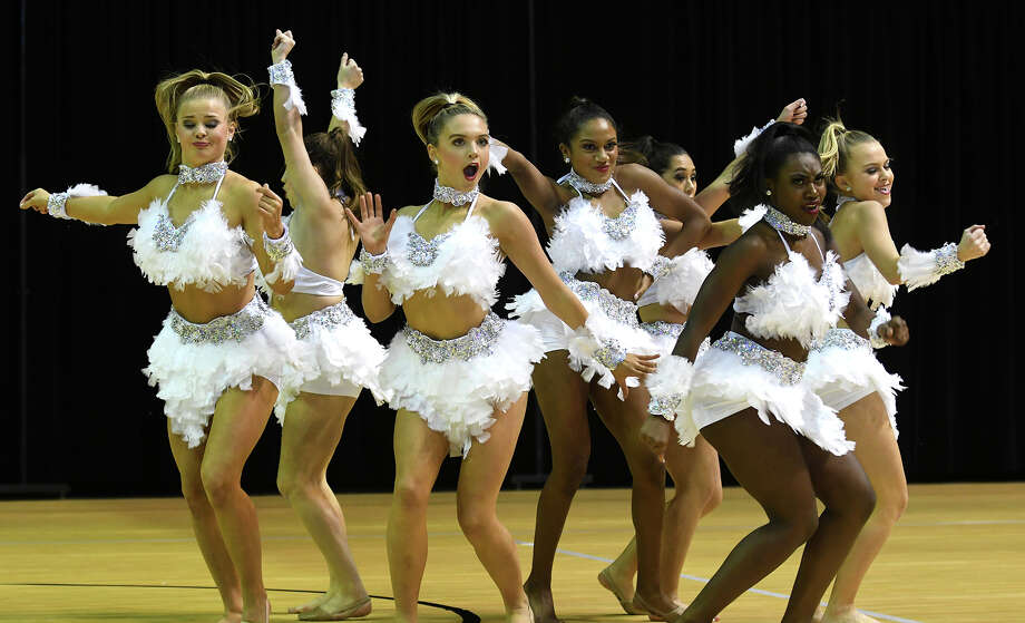 Sophomore Lieutenant Faith Stuchly, from left, sophomore Lieutenant Lisa Sarabia, sophomore Lieutenant Anna Rogers, junior Lieutenant Kelsey Holland, junior Lieutenant Zaria Sumling, senior and First Lieutenant Kathryne Nosker, and senior and Captain Katie Patrick perform their Officer Novelty routine at the 2018 Cy-Fair ISD Dance Showoff at the Berry Center on Jan. 20, 2018. (Photo by Jerry Baker/Freelance) Photo: Jerry Baker, Freelance / Freelance