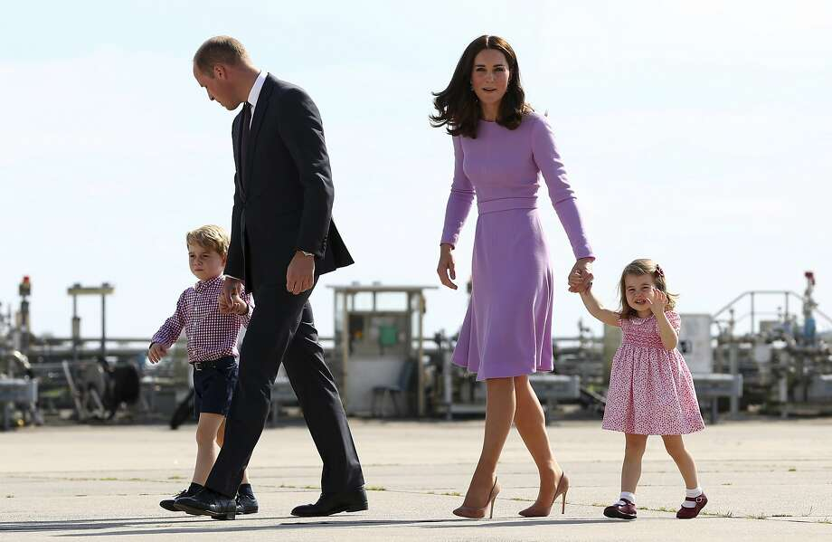 In this Friday, July 21, 2017 file photo Britain's Prince William, second left, and his wife Kate, the Duchess of Cambridge, second right, and their children, Prince George, left, and Princess Charlotte, right are on their way to board a plane in Hamburg, Germany. Kensington Palace says Prince William and his wife, the Duchess of Cambridge, are expecting their third child.  Photo: Christian Charisius, Associated Press