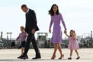 FILE - In this Friday, July 21, 2017 file photo Britain's Prince William, second left, and his wife Kate, the Duchess of Cambridge, second right, and their children, Prince George, left, and Princess Charlotte, right are on their way to board a plane in Hamburg, Germany. Kensington Palace says Prince William and his wife, the Duchess of Cambridge, are expecting their third child. The announcement released in a statement Monday Sept. 4, 2017 says the queen is delighted by the news. ( Christian Charisius/Pool Photo via AP, File)