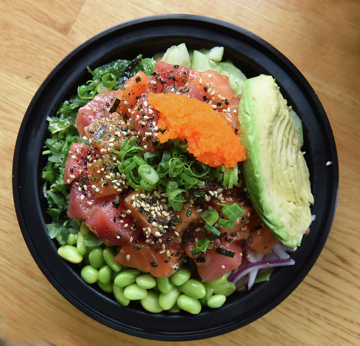 2-protein poke bowl at Bespoki Bowl at 122 Forth St. on Friday, Jan. 19, 2018 in Troy, N.Y. Half tuna and half salmon base, yuzu ponzu marinade, spicy mayo sauce, all the toppings including avocado. (Lori Van Buren/Times Union)