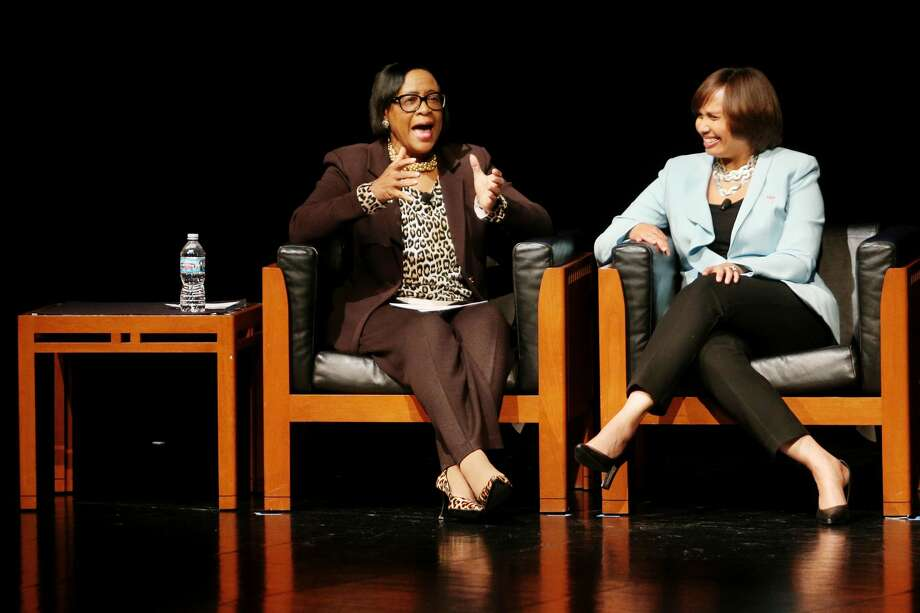 """Cynthia """"Cynt"""" Marshall, president and chief executive officer of Marshalling Resources, left, chats with Karen S. Carter, the new chief inclusion officer at Dow, during an open discussion during the MLK Regional Celebration at Saginaw Valley State University on Wednesday, Jan. 24, 2018. (Samantha Madar/for the Daily News) Photo: (Samantha Madar/for The Daily News)"""