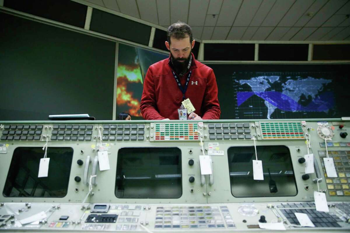 Gravitate historical preservation lead Adam Graves helps prepare the flight control consoles at Johnson Space Center's Historic Mission Control for their trip to the Cosmosphere in Kansas for restoration Thursday, Jan. 25, 2018 in Houston.