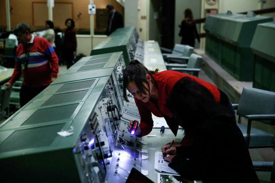 Cosmosphere curator Shannon Whetzel, center, works with NASA property accountant Marilyn Blevins to catalogue all the pieces of the flight control consoles at Johnson Space Center's Historic Mission Control as they are prepared for their trip to the Cosmosphere in Kansas for restoration Thursday, Jan. 25, 2018 in Houston. Photo: Michael Ciaglo, Houston Chronicle / Michael Ciaglo