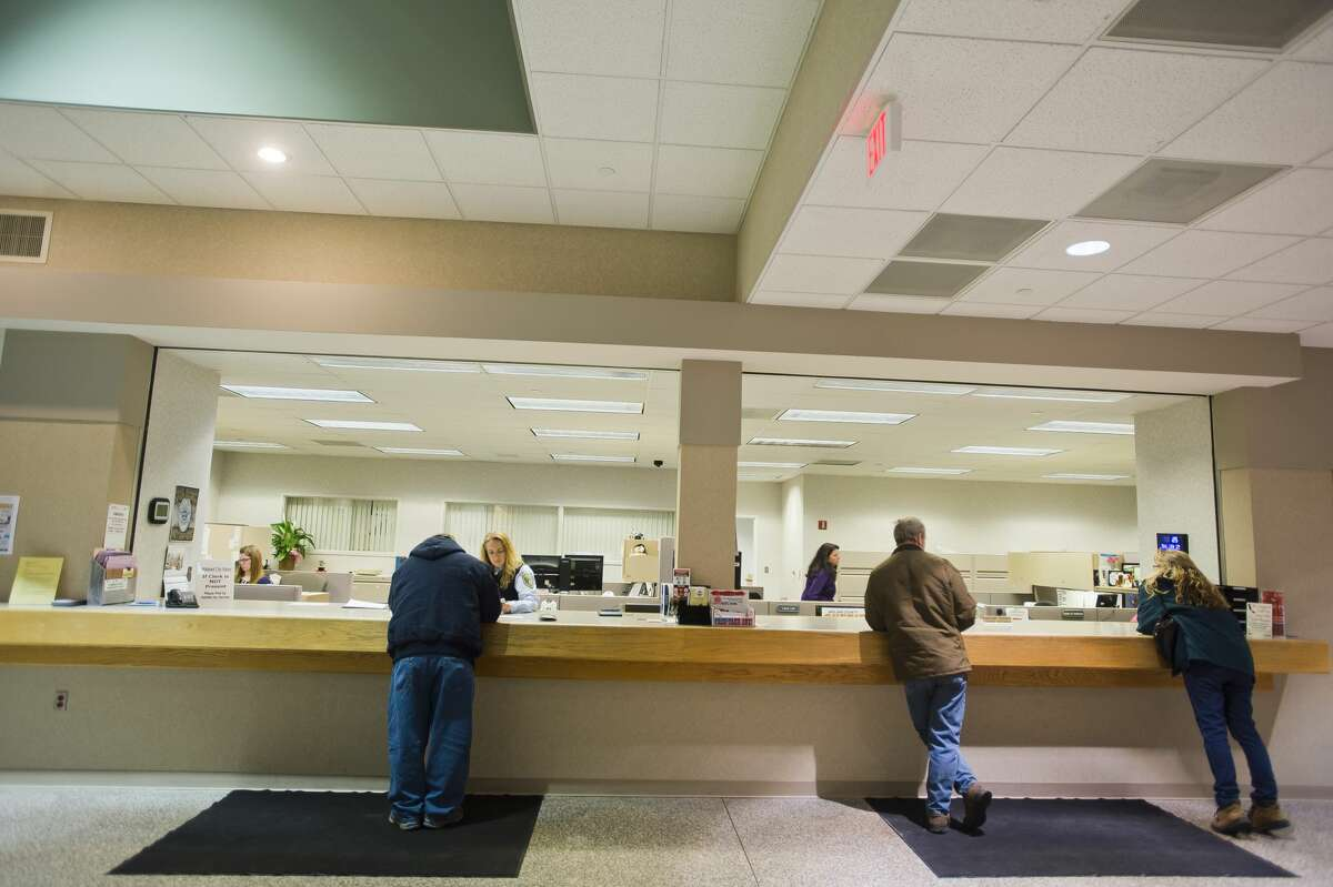 People get assistance from staff inside the Law Enforcement Center at 2727 Rodd St. on Thursday, Jan. 25, 2018. Renovations are planned for the facility, which will include additional security features for the front desk area. (Katy Kildee/kkildee@mdn.net)