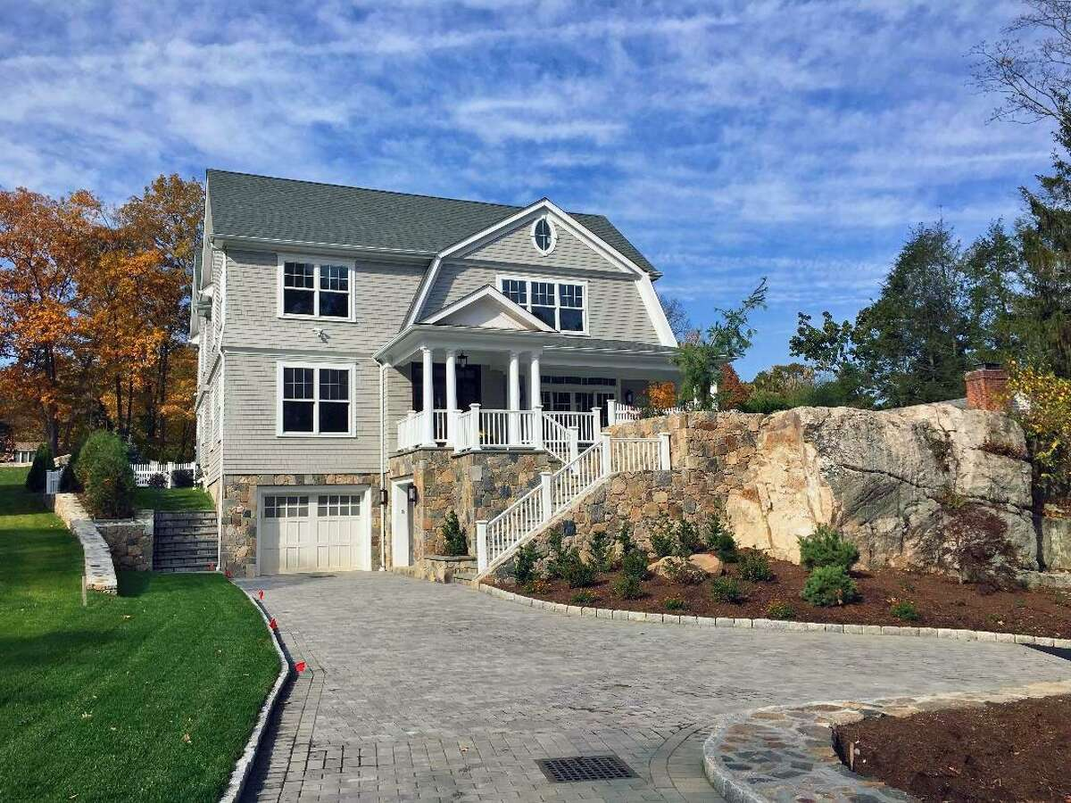 A wooded, rock-covered lot at 196 Valley Road in the Cos Cob section of Greenwich was a particularly challenging lot on which to build a home. The fieldstone taken from the property was incorporated into the site, giving it an organic feel.