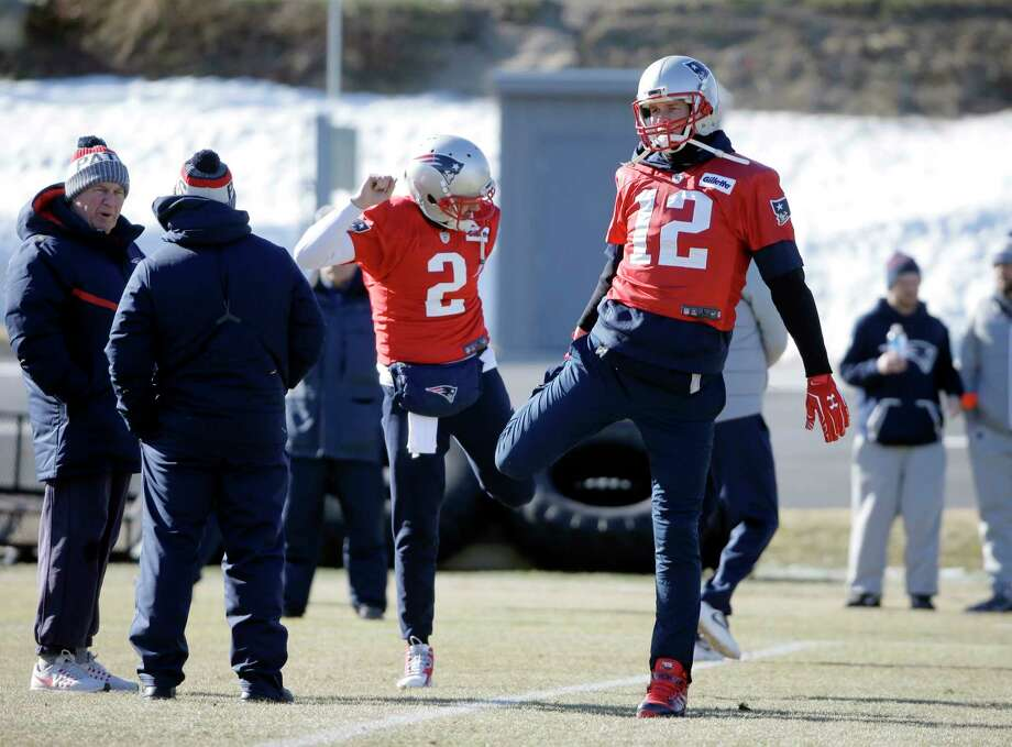 New England Patriots quarterbacks Brian Hoyer (2) and Tom Brady (12) warm up during an NFL football practice, Thursday, Jan. 25, 2018, in Foxborough, Mass. The Patriots are to play the Philadelphia Eagles in Super Bowl 52, Sunday, Feb. 4, in Minneapolis. (AP Photo/Steven Senne) Photo: Steven Senne, Associated Press / Copyright 2018 The Associated Press. All rights reserved.