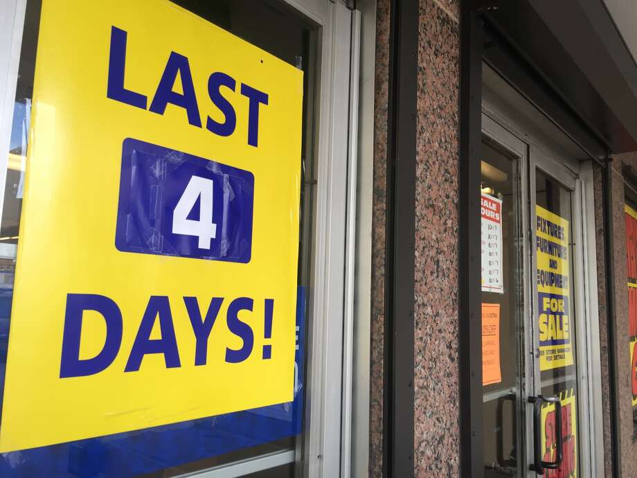 A sign outside the Sears store Thursday in Midtown counts down to the final closing. Photo: J.R. Gonzales, Houston Chronicle