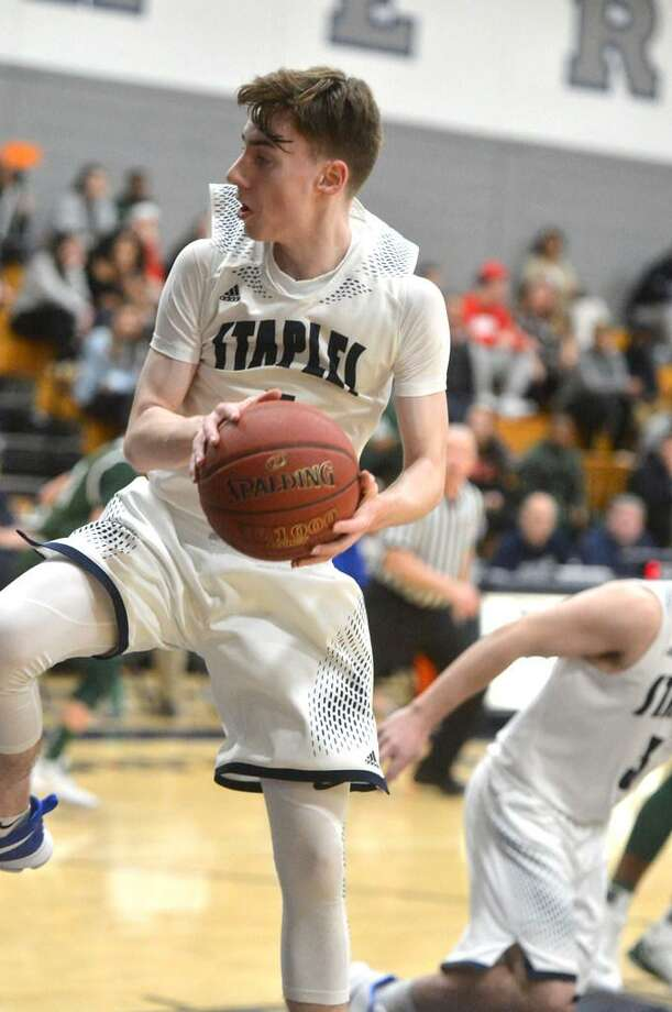 Freshman guard Luke Murphy grabs a rebound during Staples' game against Norwalk on Tuesday night. Murphy has been a bright spot this season for the Wreckers. Photo: Alex Von Kleydorff / Hearst Connecticut Media