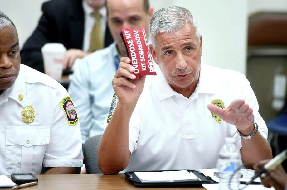 Rick Fontana, deputy director of emergency operations at the Office of Emergency Management and Homeland Security, holds up an overdose kit while making a point at a roundtable discussion at the New Haven Police Department in 2016 about efforts to curb the opioid epidemic. Photo: Arnold Gold / Hearst Connecticut Media