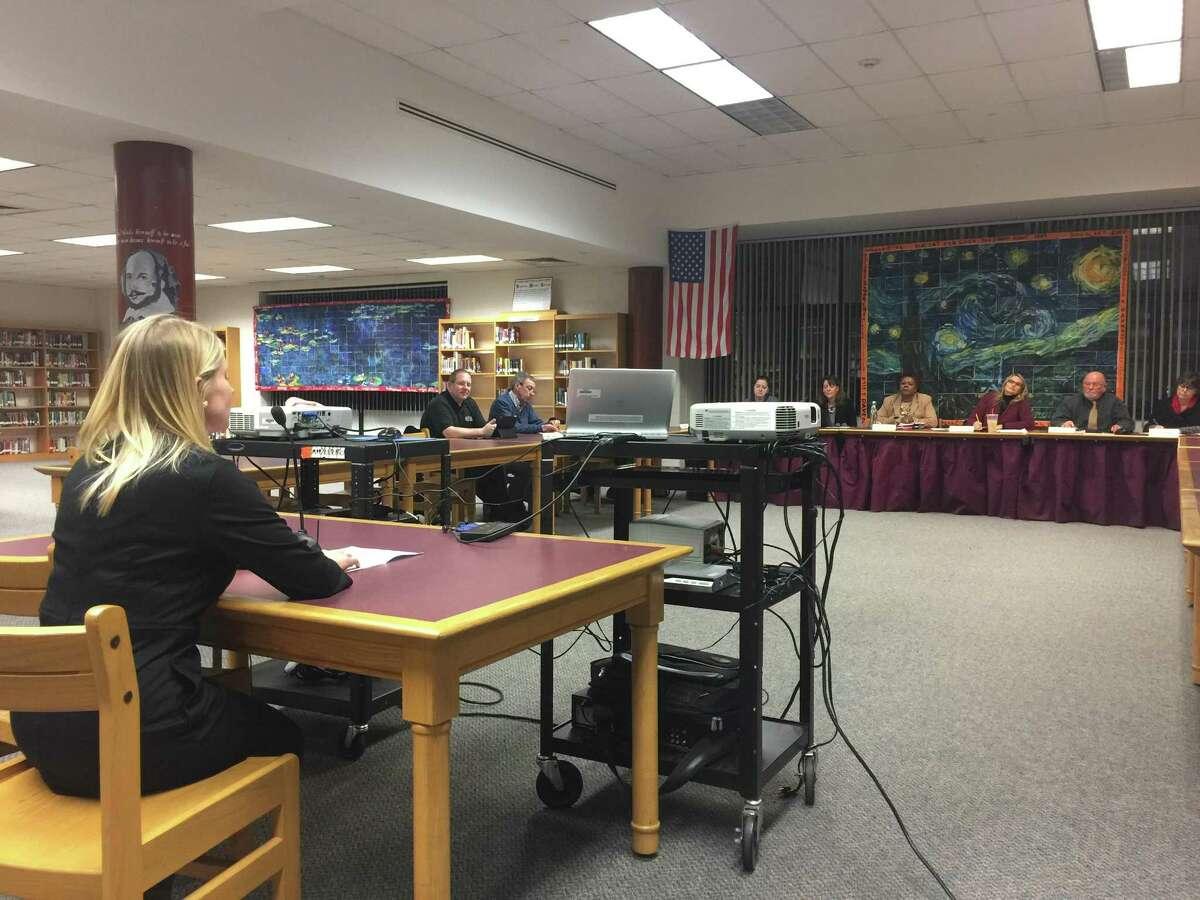 Parent Keri Hoehne addresses the Torrington Board of Education and Superintendent Denise Clemons Wednesday evening.