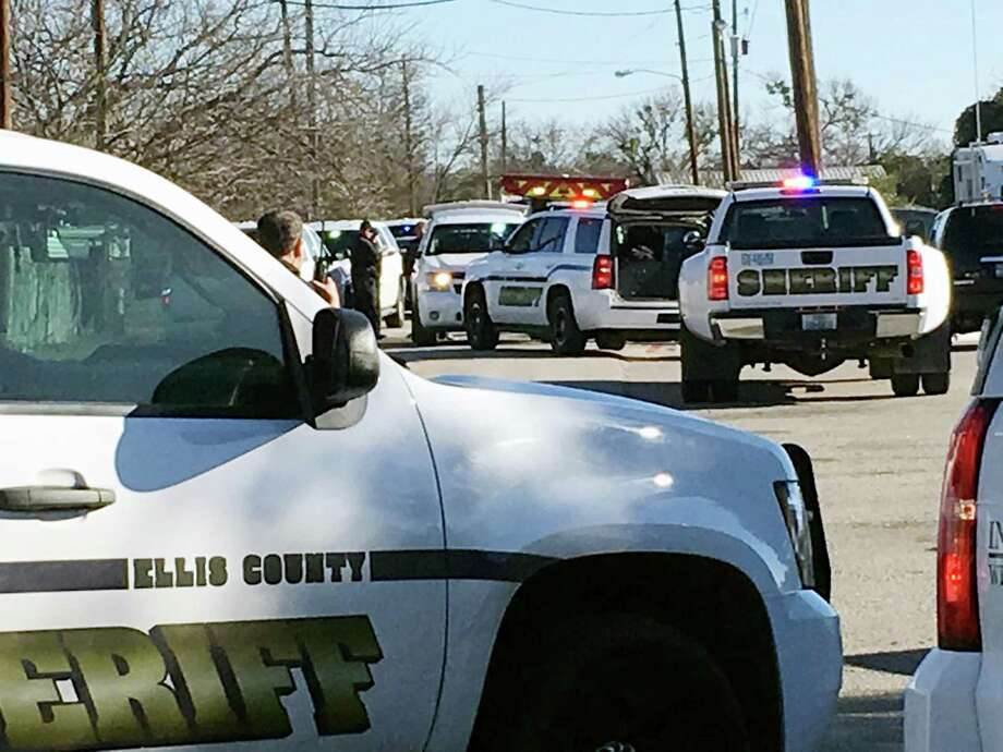 Ellis County Sheriff's Office personnel converge on Italy High School, in the small town of Italy, about 40 miles south of Dallas, after a 15-year-old girl was shot in the cafeteria. Photo: Jennifer Lindgren / Associated Press / KTVT Dallas Fort Worth