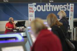 CHICAGO, IL - JANUARY 25:  Southwest Airlines passengers check in for flights at Midway Airport on January 25, 2018 in Chicago, Illinois. Southwest Airlines said that fourth-quarter profit jumped to $1.89 billion as the recent changes in the tax law reduced the company's deferred tax liability. The changes are also expected to boost 2018 earnings.  (Photo by Scott Olson/Getty Images)